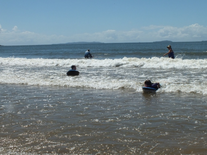 Kids learning to ride their Boogey Boards