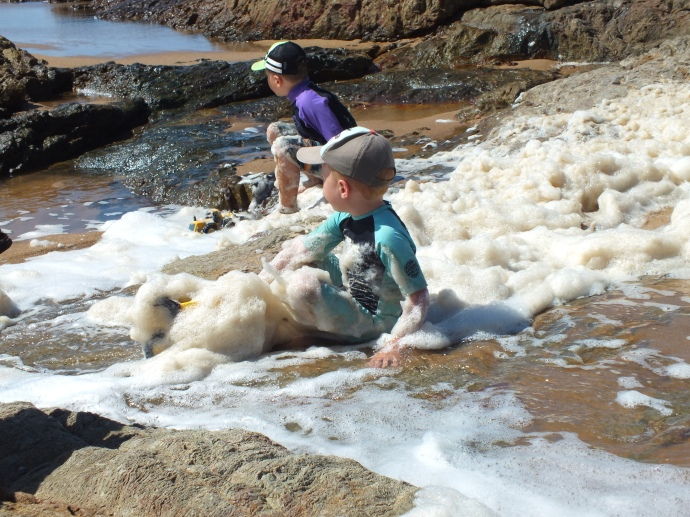 The boys loved playing in the sea foam
