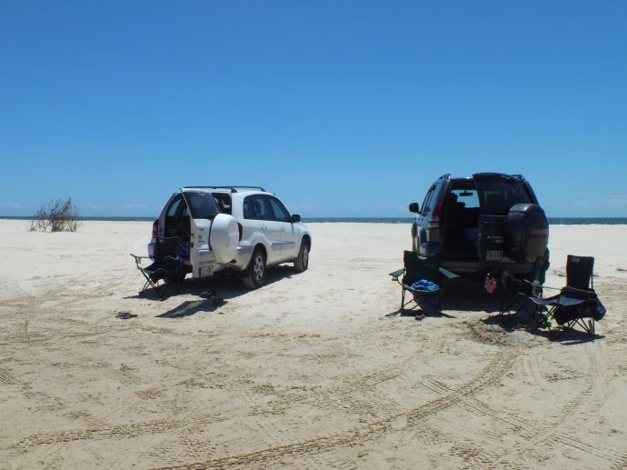 Cars on the beach in front of Welsby Lagoon