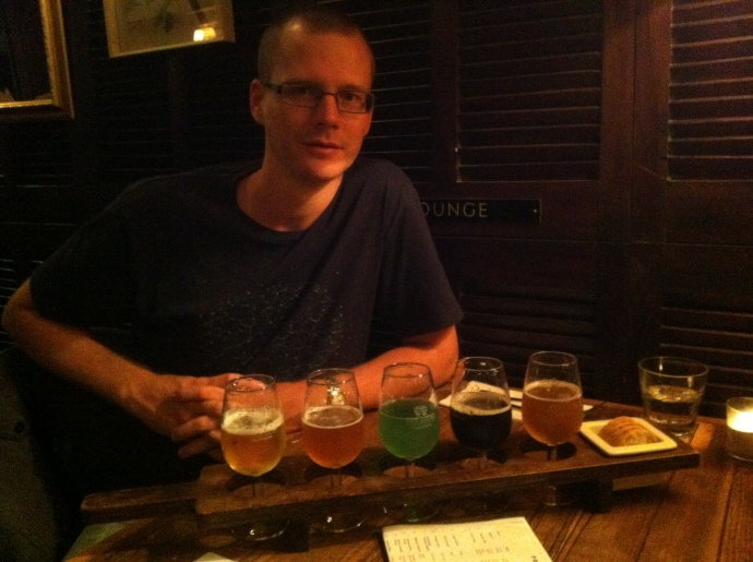 Matt's Beer paddle - five different craft beers for tasting including the green one made using squid ink!  It was refreshing apparently!