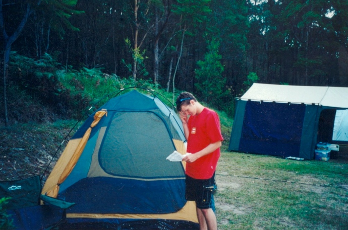 Reading the instructions to work out how to get the tent up properly!