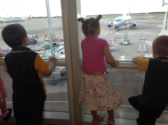 Watching Grammy's plane arrive!