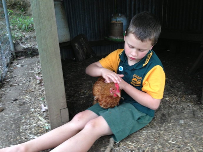 Giving his chooks some quality time before we go!