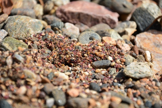 The sand is literally crushed Garnets!