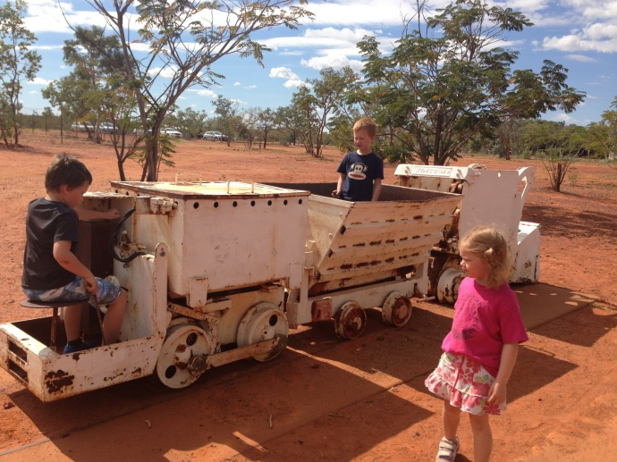 The kids checking out the old gold mining trolley on the walk to the library in Tennant Creek