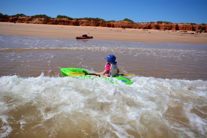 Lex having a go in the kayak at Riddell Beach