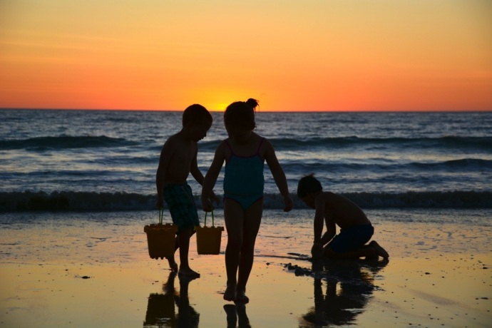 Sooooo hard to drag the kids away from the beach at sunset!