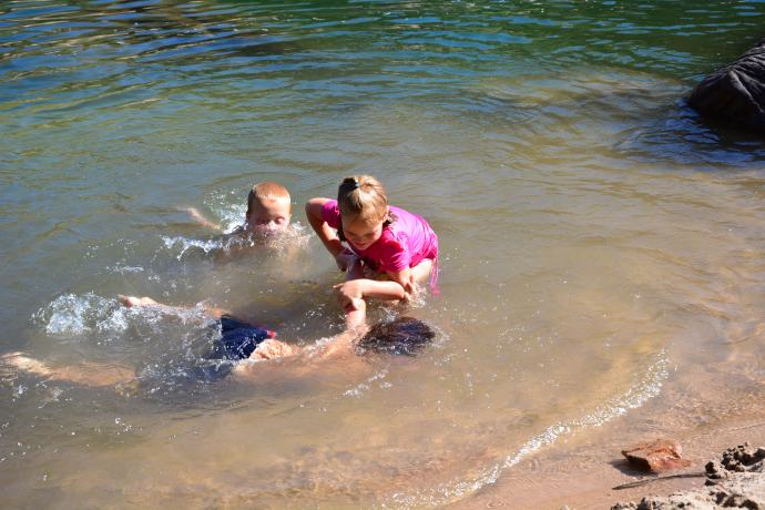 The kids wrestling in the water!