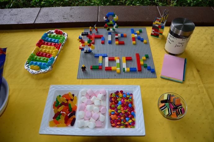 Lego block biscuits, guess the lego in the jar game created by Jack, lego teaspoon holder made by Toby and Jack, and Lego '8 year old' board created by Jack and Toby