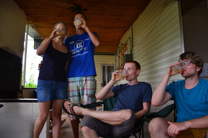 The german backpackers tasting the passion fruit wine!