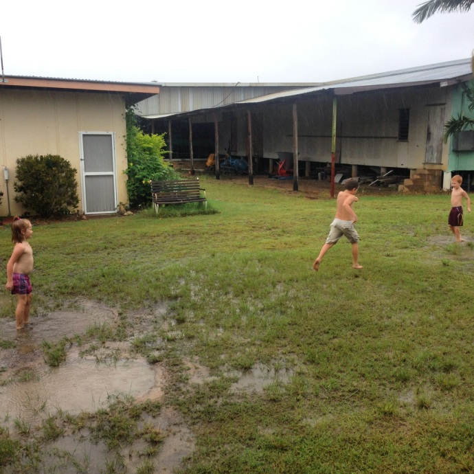 Kids making the most of the rain brought by Cyclone Ita!