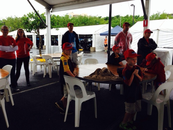 Our crew watching the big race screen while waiting for the onslaught of athletes to arrive.