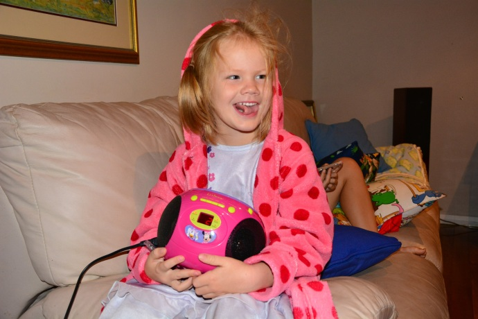 So happy with her pink CD player!