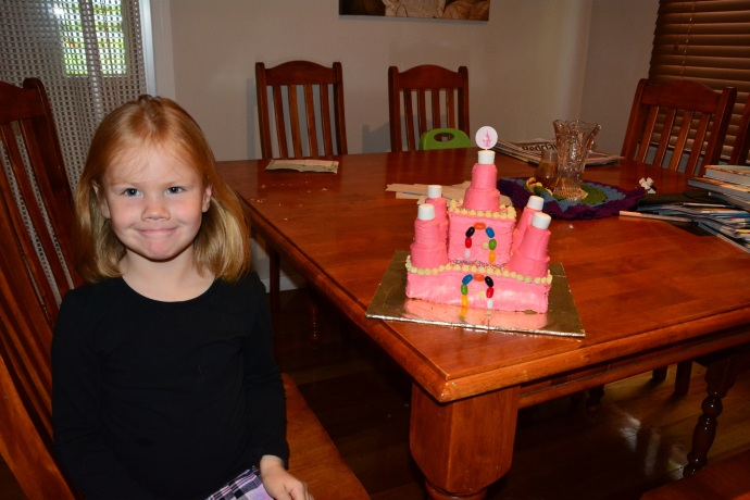 A photo of the birthday girl with her castle cake before we left home just in case it didn't make it to the picnic in one piece!