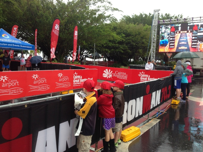 The kids at the finishing tunnel of the Ironman, cheering on the winner Cameron Brown.